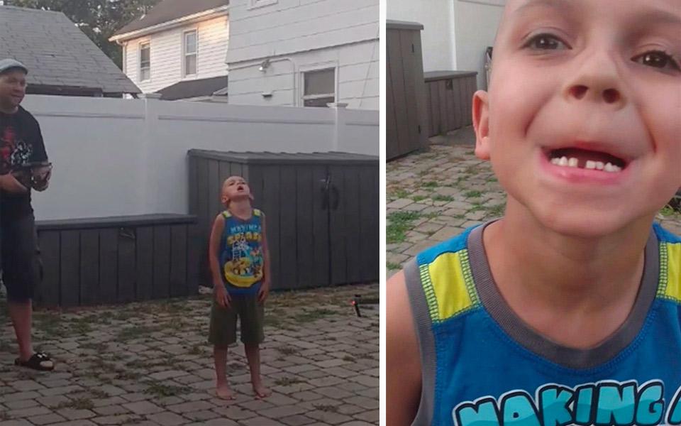 Far bruger drone til at trække sin søns tand ud